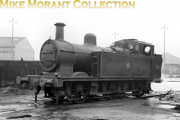 Vintage Irish Railways - Northern Ireland - UTAIn 1944 the Northern Counties Committee was desperately short of shunting engines and negotiated the purchase of two Jinty 0-6-0T's from the LMSR. Neither was an LMS product and this example, 'Y' class No. 18, had been built by Bagnall bearing LMS No. 7456 before being converted to the Irish broad gauge. No. 18 performed her mundane tasks in Belfast until withdrawal in 1956 where as her sister, No. 19, worked on until 1963. Strangely, I have two almost identical negatives from different sources featuring No. 18 but none of the longer lived sibling. [Mike Morant collection]